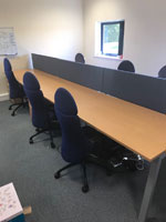 Swindon, Wiltshire 6 person beech 1400mm bench desks with pedestals and screens