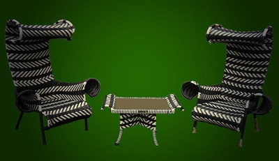 Scorpion chairs and small table made of Rattan
